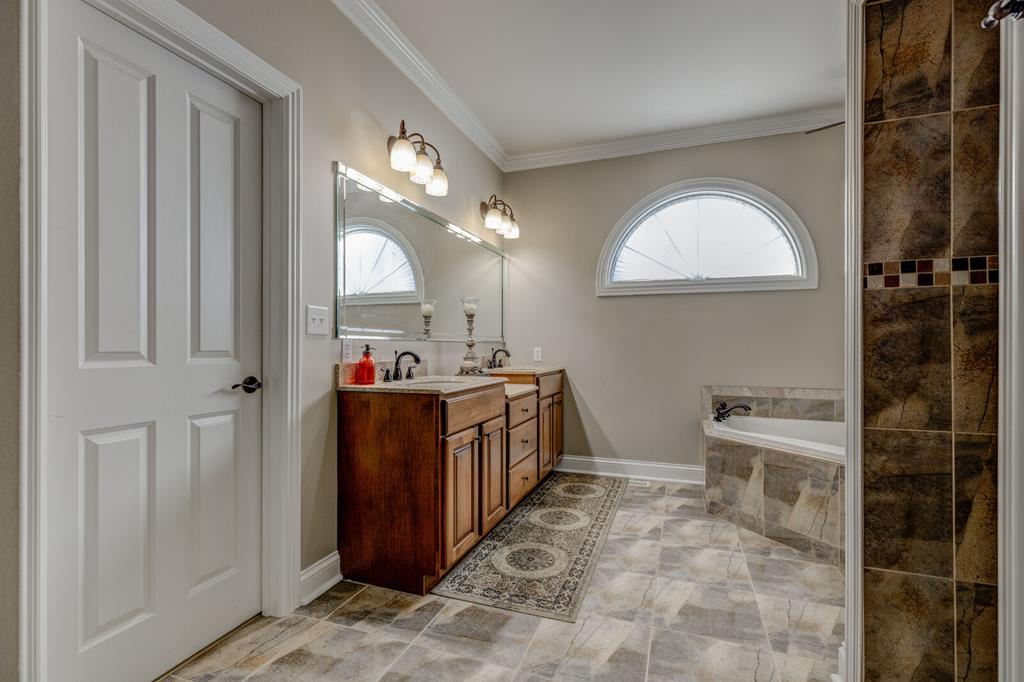Master bath with jacuzzi & walk in shower
